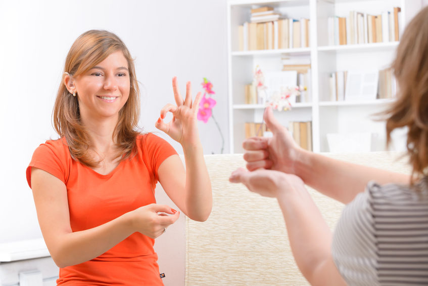 smiling deaf woman learning sign language - LIS